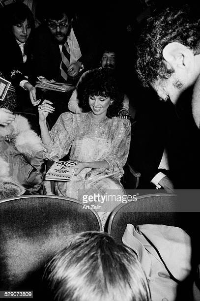 Marie Osmond seated at a theater signing autographs circa 1960 New York