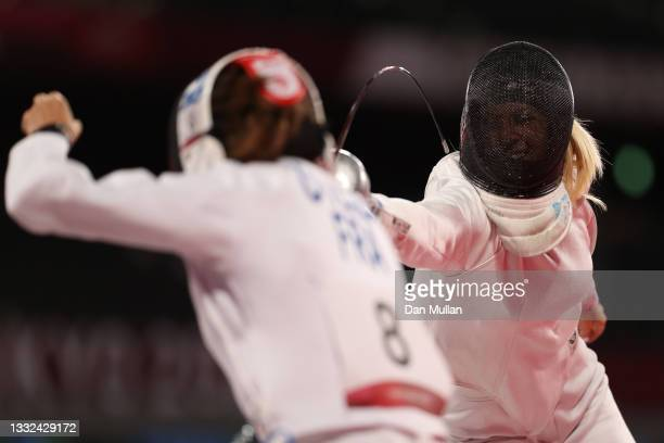 Marie Oteiza of Team France and Samantha Schultz of Team United States compete during the Fencing Ranked Round of the Women's Modern Pentathlon on...