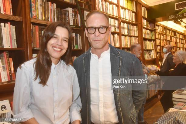 """Marie Ottavi and Fabrice Leonard attend """"Karl"""" by Marie Ottavi Book Signing at Librairie Galignagni on September 21, 2021 in Paris, France."""