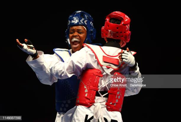 Marie Paule Ble of France and Da Bin Lee of South Korea during their Semi Final of the Women's 73kg division at The World Taekwondo Championships at...