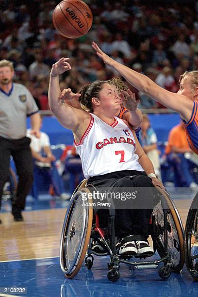 Marie Peters of Canada shoots the ball in Womens Wheelchair Basketball against Team Netherlands during the Sydney 2000 Paralympic Games on October 25...