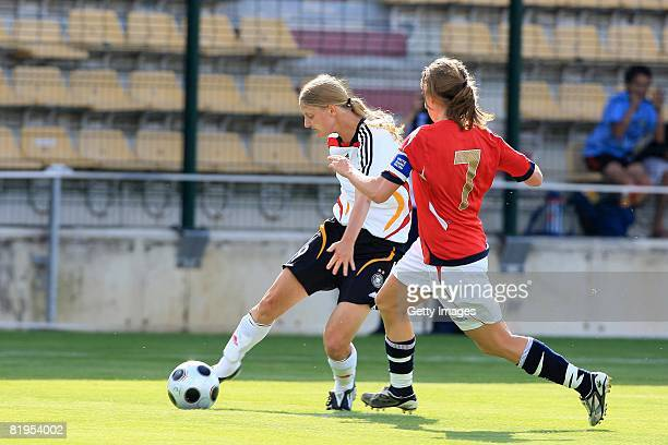 Marie Pollmann of Germany and Maren Mjelde of Norway fight for the ball during the Women's U19 European Championship match between Germany and Norway...