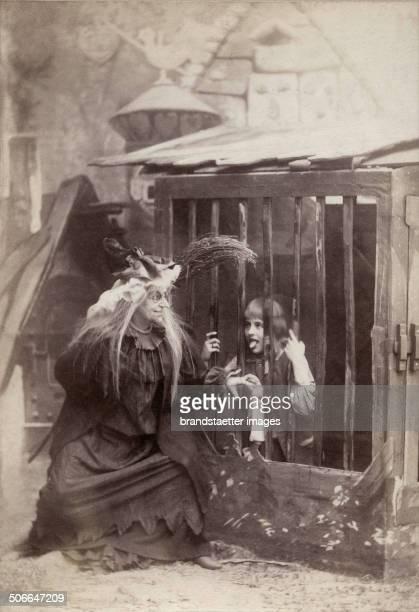 Marie Ranard as Hansel and Marie Lehmann as the Gingerbread Witch in the opera >Hansel and Gretel< by Engelbert Humperdinck Vienna Hofoper December...
