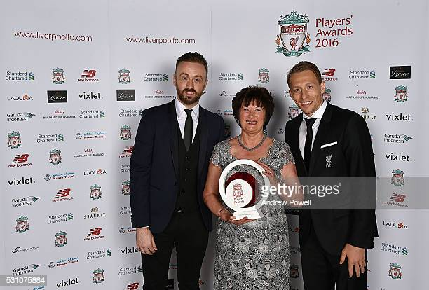 Marie Rooney poses with the Bill Shankly Community award with Lucas Leiva and Chris Shankly at the Liverpool FC End of Season Awards at The...