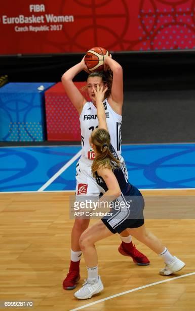 Marie Ruzickova of Slovakia tries to block Alexia Chartereau of France during the FIBA EuroBasket women's quarterfinal match between France v...
