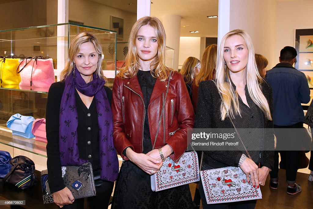 Marie Saldmann, Founder of 'Naked Heart Foundation', Model Natalia Vodianova and Creator of 'Preciously Paris', Carole Tessier attend the 'Preciously Paris Bag', created to benefit Naked Heart Foundation : Launch Cocktail at Colette on November 12, 2015 in Paris, France.