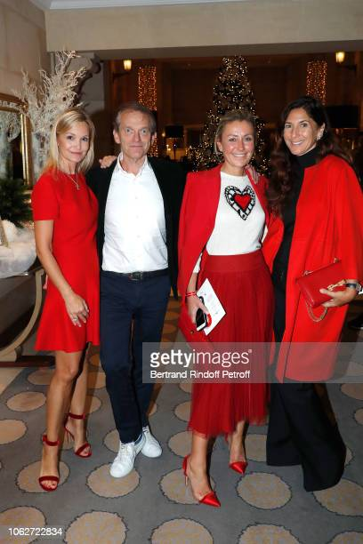 Marie Saldmann her husband Doctor Frederic Saldmann Claire DurocDanner and Karine Journo attend the Sauvez le Coeur des Femmes Red Defile Show at...