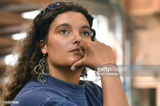 Marie Tabarly , the daughter of French international skipper Eric Tabarly looks over during her visit to the Le Chantier du Guip's shipyard in Brest,...