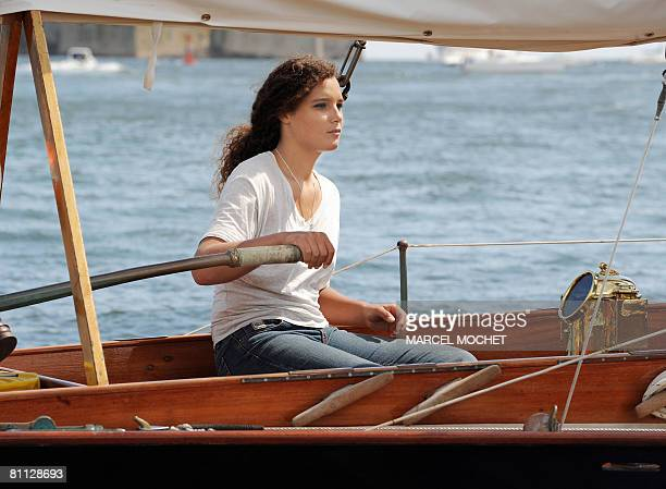 Marie Tabarly, the daughter of French sailing legend late Eric Tabarly, competes aboard her father's monohull 'Pen Duick I' during the opening of...