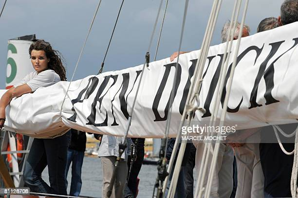 Marie Tabarly the daughter of French sailing legend late Eric Tabarly poses aboard her father's monohull 'Pen Duick I' during the opening of 'City of...