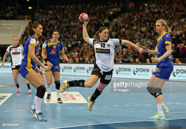 Marie Wall of Sweden and Anna Loerper of Germany and Jenny Alm of Sweden battle for the ball during the match Germany vs Sweden at Barclaycard Arena...