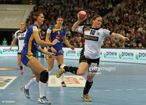 Marie Wall of Sweden and Carin Strömberg of Sweden and Anna Loerper of Germany battle for the ball during the match Germany vs Sweden at Barclaycard...