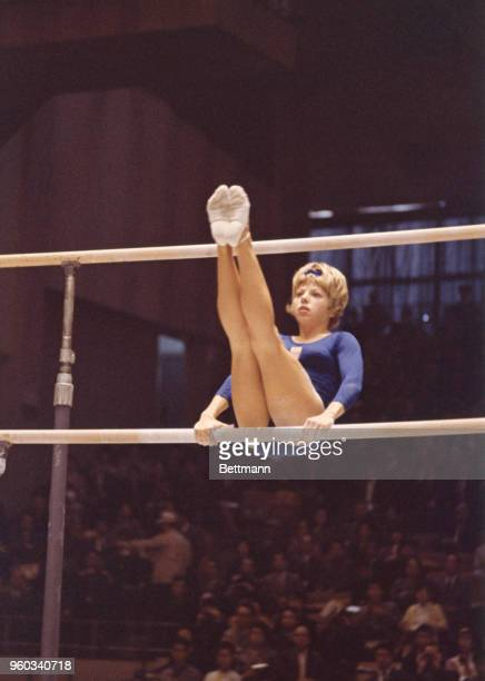 Marie Walther of US exhibits form on bar P during the Women's Gymnastics events