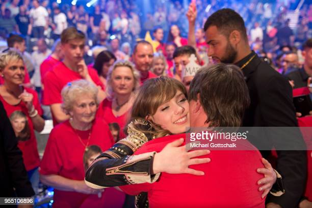 Marie Wegener, winner of 'Deutschland sucht den Superstar', hugs her father during the finals of the tv competition 'Deutschland sucht den Superstar'...