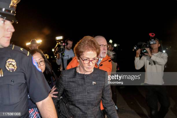 Marie Yovanovitch former US Ambassador to Ukraine center leaves Capitol Hill after a closeddoor deposition before House committees in Washington DC...
