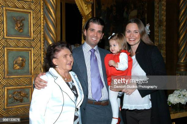 Marie Zelnickova stands with her grandson Donald Trump Jr and his first daughter Kai Madison and wife Vanessa Kay Haydon at the MarALago estate Palm...