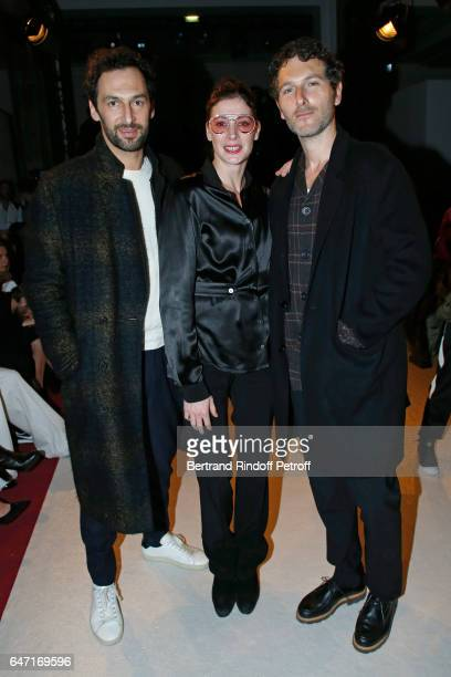 MarieAgnes Gillot standing between Musicians Olivier Coursier and Simon Buret attend the Alexis Mabille show as part of the Paris Fashion Week...