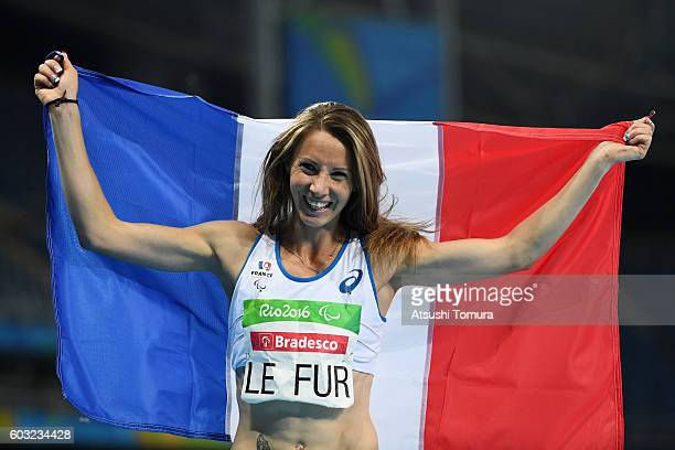 MarieAmelie le Fur of France celebrates winning the gold medal after competing in the Women's 400m T44 Final on day 5 of the Rio 2016 Paralympic...