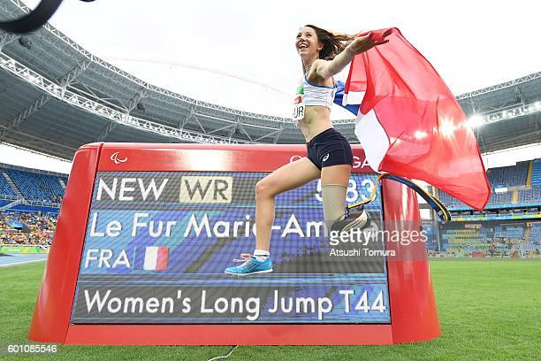 MarieAmelie Le Fur of France poses after setting a new world record in the Women's Long Jump T44 final during the Rio 2016 Paralympic Games at Olymic...