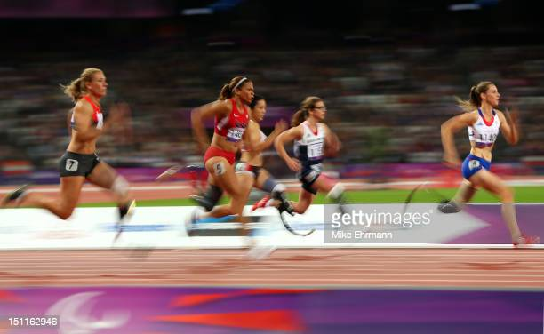 MarieAmelie le Fur of France trips leads ahead of April Homes of the United States Women's 100m — T44 Final on day 4 of the London 2012 Paralympic...