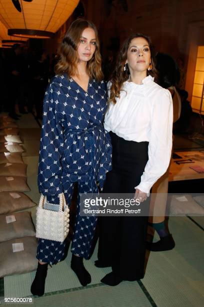 MarieAnge Casta and Alysson Paradis attend the HM show as part of the Paris Fashion Week Womenswear Fall/Winter 2018/2019 on February 28 2018 in...