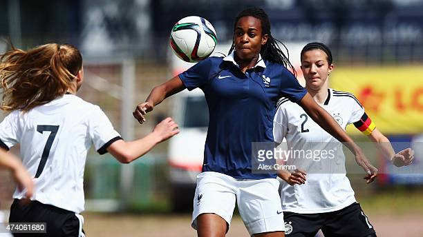 MarieAntionette Katoto of France is challenged by Giulia Gwinn and Vildan Kardesler of Germany during the U17 girls international friendly match...