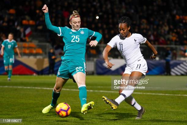 MarieAntoinette Katoto of France shoots the ball against Johanna Elsig of Germany during the International Friendly game between France and Germany...