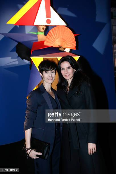 MarieClaude Pietragalla and Marie Drucker pose in front the works of JeanPaul Goude during the Societe des Amis du Musee d'Art Moderne du Centre...