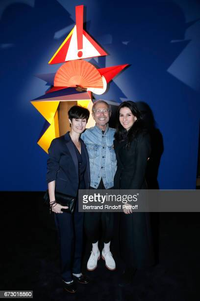 MarieClaude Pietragalla JeanPaul Goude and Marie Drucker pose in front the works of JeanPaul Goude during the Societe des Amis du Musee d'Art Moderne...