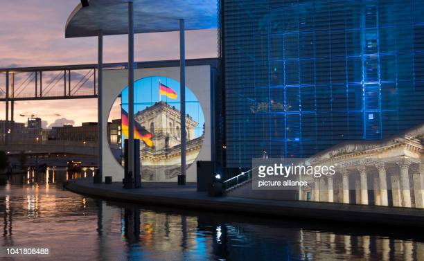 MarieElisabethLueders house shines colourfully in the evening during the largescreen production 'Dem deutschen Volke' in Berlin Germany 12 July 2016...