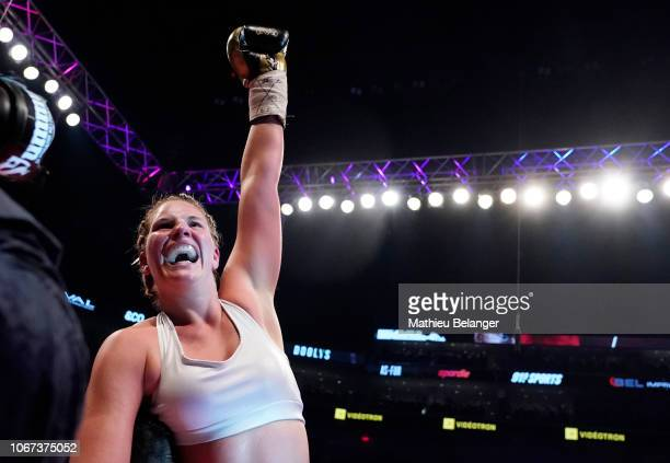 MarieEve Dicaire celebrates after defeating Chris Namus during their women IBF light welterweight championship fight at the Videotron Center on...