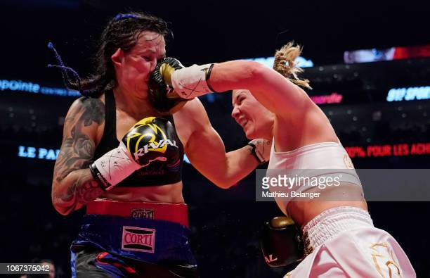 MarieEve Dicaire punches Chris Namus during their women IBF light welterweight championship fight at the Videotron Center on December 1 2018 in...