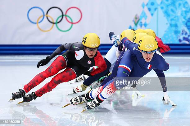 MarieEve Drolet of Canada and Veronique Pierron of France skate during the Ladies' 1500m Short Track Speed Skating heats on day 8 of the Sochi 2014...