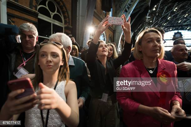 MarieFrance van Heel the wife of former Labour Cabinet minister Andy Burnham uses a mobile phone to record as he is elected as Mayor of Greater...