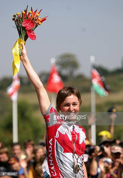 MarieHelene Premont of Canada waves to the crowd after being presented with her gold medal following her victory in the Women's Individual Cross...