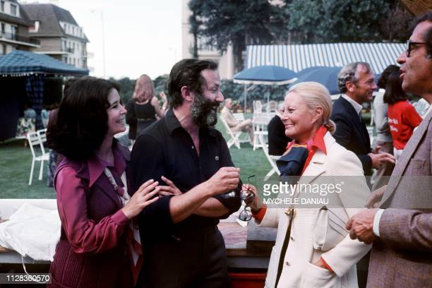 MarieJose Nat her husband Michel Drach Michele Morgan and Roger Vadim joke on September 10 1975 during the 1st American Film Festival of Deauville