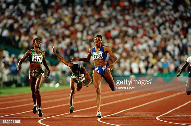 MarieJose Perec heads to victory in the women's 200meter run at the 1996 Olympic Games Merlene Ottey finished second