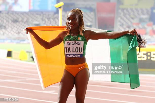 Marie-Josée Ta Lou of the Ivory Coast, bronze, celebrates after the Women's 100 Metres final during day three of 17th IAAF World Athletics...
