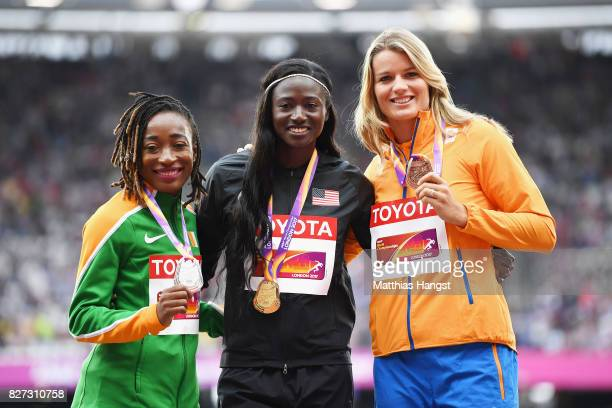 MarieJosee Ta Lou of Cote d'Ivoire silver Tori Bowie of the United States gold and Dafne Schippers of the Netherlands bronze pose with their medal...