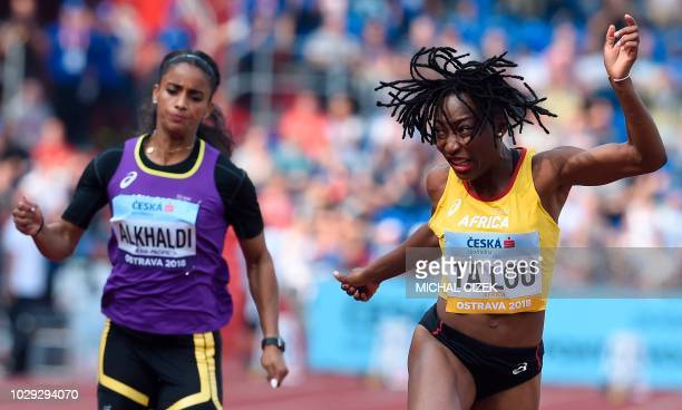 TOPSHOT MarieJosee Ta Lou of Ivory Coast of Team Africa and Hajar Alkhaldi of Team Asia and Pacific compete in the Women 100m event at the IAAF...