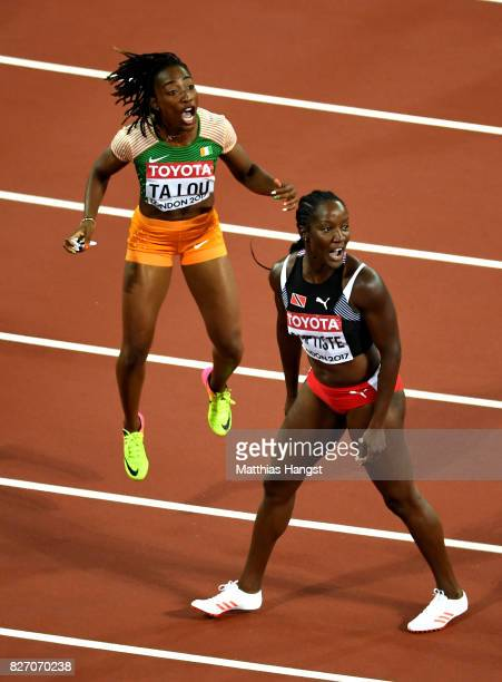 Marie-Josee Ta Lou of the Ivory Coast and Kelly-Ann Baptiste of Trinidad and Tobago react after finishing the Women's 100 Metres Final during day...