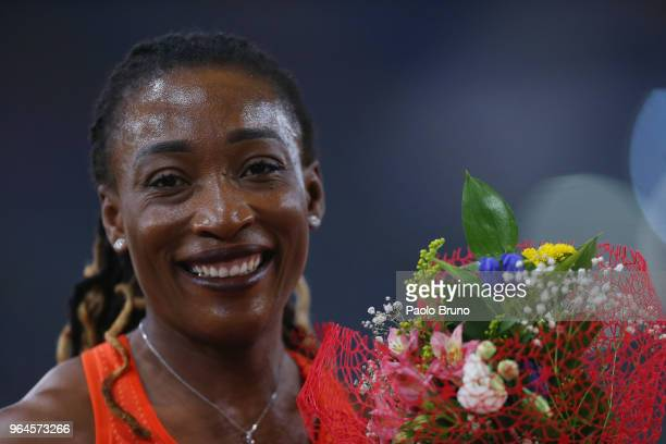 Marie-Josee Ta Lou of the Ivory Coast celebrates after winning the women's 200m during the IAAF Golden Gala Pietro Mennea at Olimpico Stadium on May...