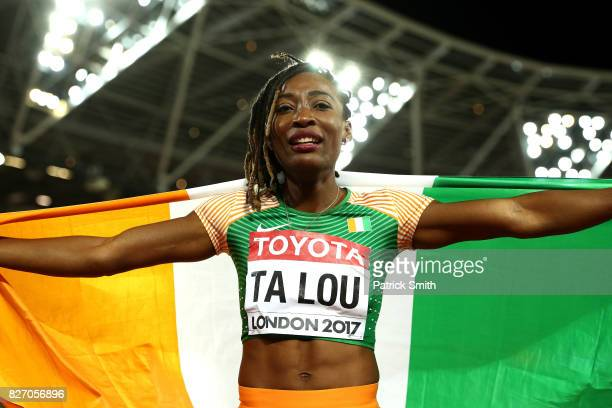 Marie-Josee Ta Lou of the Ivory Coast celebrates winning silver in the Women's 100 Metres Final during day three of the 16th IAAF World Athletics...