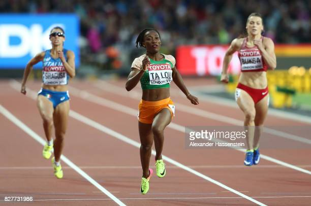 Marie-Josee Ta Lou of the Ivory Coast competes in the Women's 200 metres heats during day five of the 16th IAAF World Athletics Championships London...