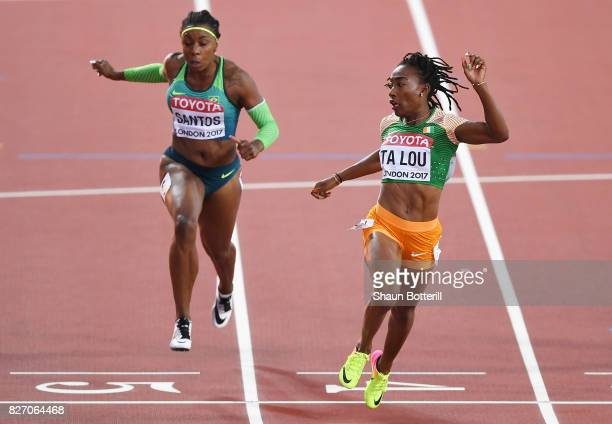 Marie-Josee Ta Lou of the Ivory Coast crosses the finishline to win silver in the Women's 100 Metres final during day three of the 16th IAAF World...
