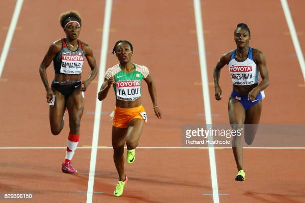 Marie-Josee Ta Lou of the Ivory Coast Dina Asher-Smith of Great Britain and Crystal Emmanuel of Canada competes in the womens 200 metres semi-finals...