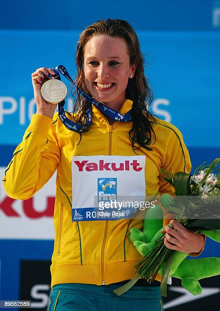 Marieke Guehrer of Australia receives the gold medal during the medal ceremony for the Women's 50m Butterfly Final during the 13th FINA World...