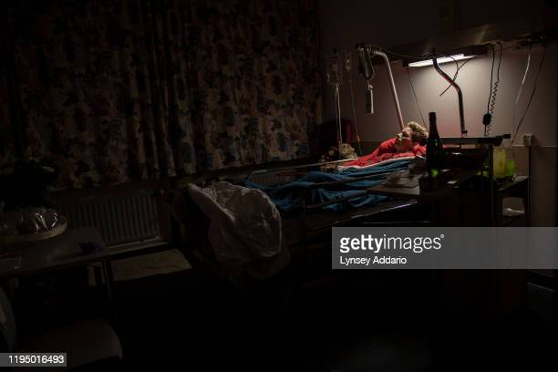 Marieke Vervoort a 38 year old Paralympic athlete sleeps in the evening while undergoing treatment for an infection in Diest Hospital in her hometown...
