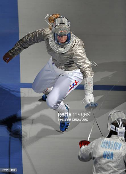 US Mariel Zagunis competes against compatriot Sada Jacobson during the women's individual sabre final match on August 9 2008 at the Fencing Hall of...