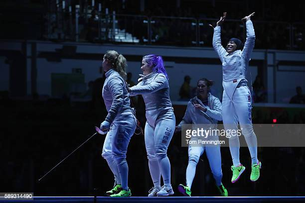 Mariel Zagunis Dagmara Wozniak Monica Aksamit and Ibtihaj Muhammad of the United States celebrate after winning the Women's Sabre Team bronze medal...
